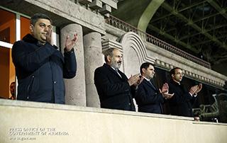 PM watches Armenia-Finland football match at stadium